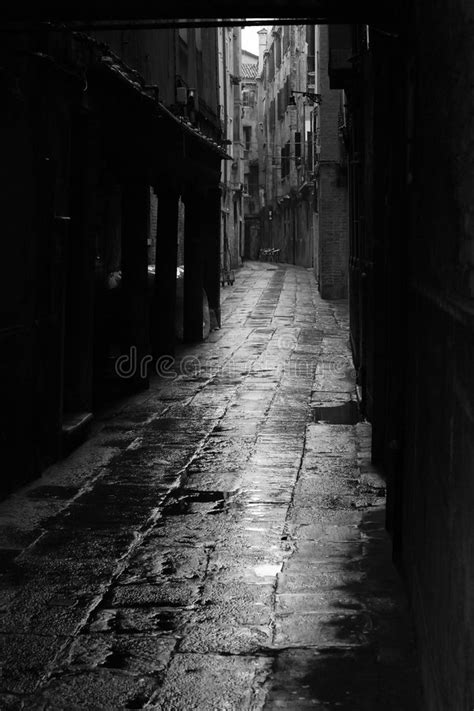 Dark alley in Venice stock image. Image of empty, building