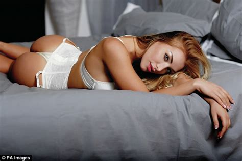 lorena sizzles as she poses on the bed wearing a hot black wags and sport beauties elisa de panicis another trophy