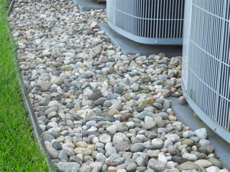 backyard pebble gravel landscaping ideas around pools landscape stone carroll