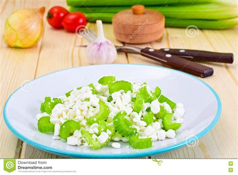 dietary dish of granulated cottage cheese and celery stock