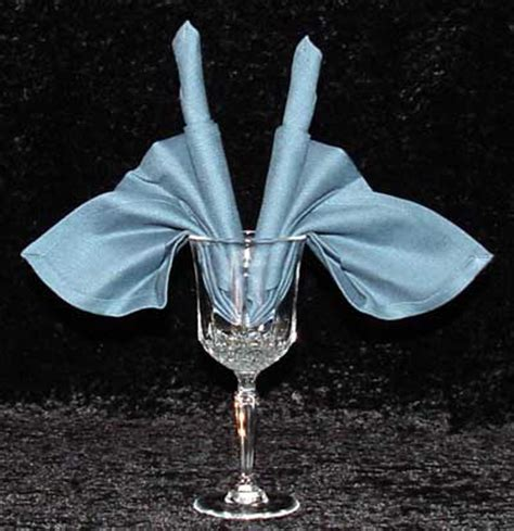 Folding Paper Napkins In Glasses - napkin folding for wine glasses
