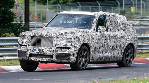 rolls royce cullinan price rolls royce cullinan suv caught racing on the ring
