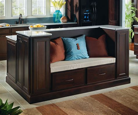 java cabinets featuring a kitchen island with seating