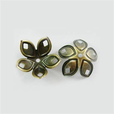 iron bead caps nickel free 5 petal antique bronze about 18mm in diameter 8mm high