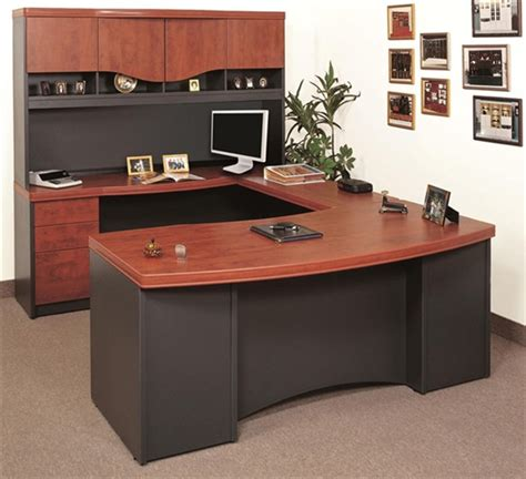 amazing ikea desk privacy screen #3: wood-finishing-top-U-shape-desk-with-drawers-and-cabinets-minimalits-flat-screen-computer-set-several-frames-as-wall-decorations.jpg