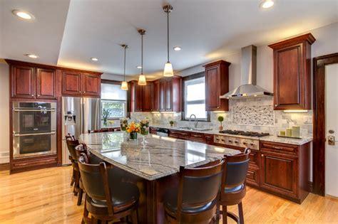 viscont white granite countertops  cherry cabinets