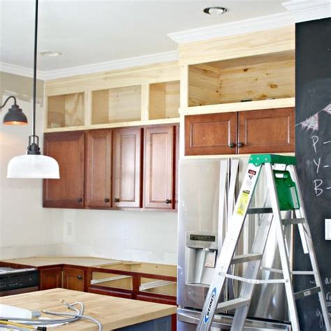 Space Above Kitchen Cabinets Ideas Thrifty Decor Kitchen Makeover Fixing That Annoying Space Above Your Cabinets Kitchens