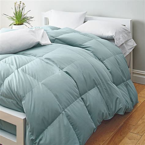 down comforter vs alternative comforter buying guide the company store