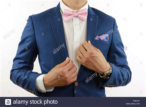 in blue suit with pink bow tie flower brooch and