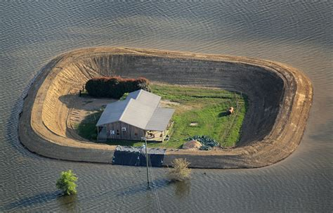 Lloyd?s Blog: Giant berm protects single family home from
