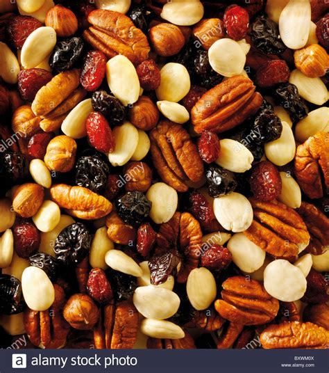 Mixed Nuts And Fruits 1 fruit and nut mix pecans almonds raisons and dried cranberry stock photo royalty free image