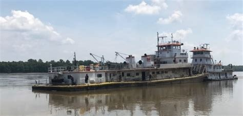 tow boat towboat eric haney raised to be repaired workboat