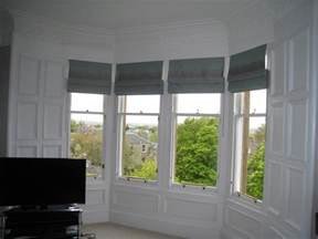 Curtains On A Window Roman Blinds For Bay Windows Ines Interiors