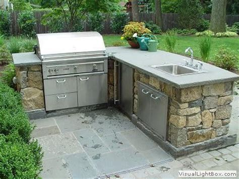 outdoor kitchen with sink living a