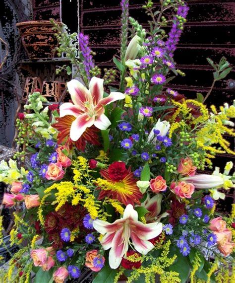 bright funeral flower arrangement heritage funeral homes