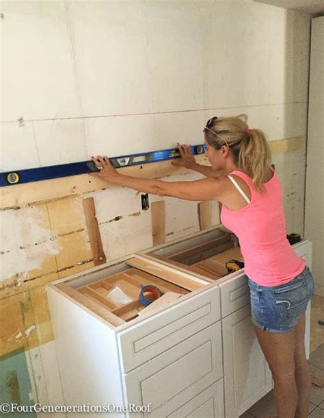 How To Install Wall Cabinets by Our Kitchen Renovation Series Installing New Cabinets