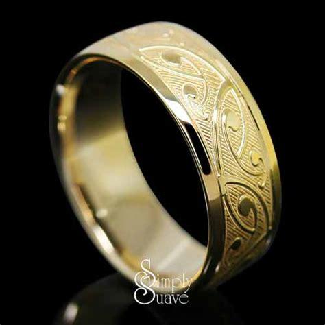 koru patterned gold band finished ring