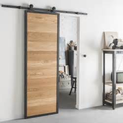 porte coulissante en bois style industriel pour une porte coulissante en bois et alu