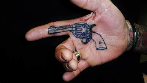 cool small hand tattoos gun images designs