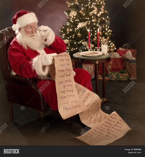santa reading christmas wish list image photo bigstock