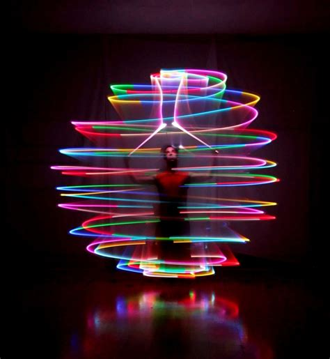poi led wand spinning lights make a magical rainbow sphere around the s subject it