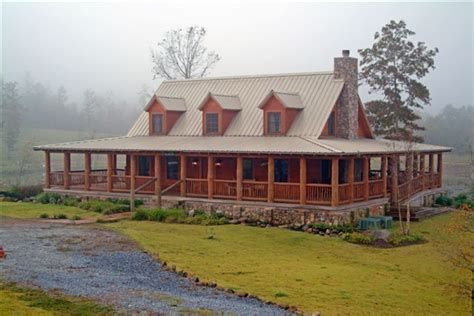ranch house with wrap around porch log cabin with a tin roof and a wrap around porch this is