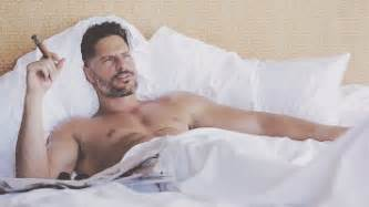in bed with actor joe manganiello in bed a cigar gif