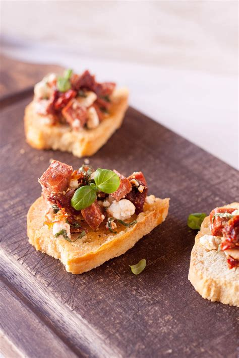 beautiful appetizers spicy sausage sun dried tomato and goat cheese crostini