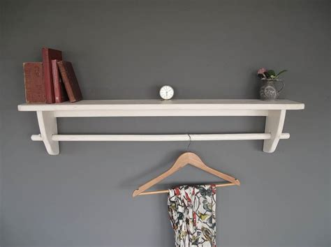 vintage styled wooden clothes rail with top shelf by