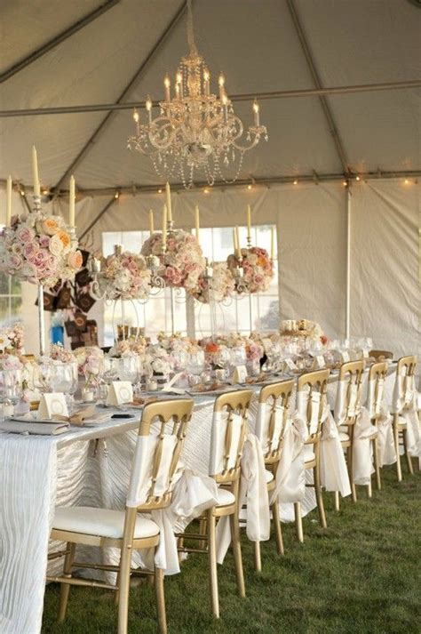 #white, blush and gold wedding reception with chandeliers
