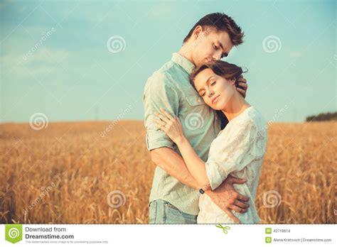 Couples In In Outdoor Hugging