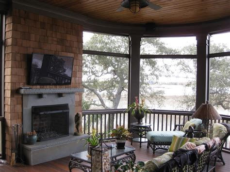 outdoor fireplace on screened porch traditional porch