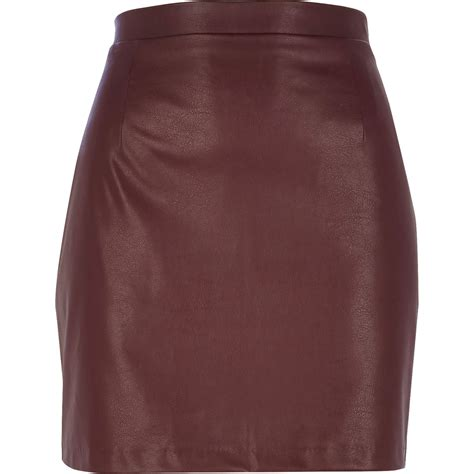 river island leather look mini skirt in lyst