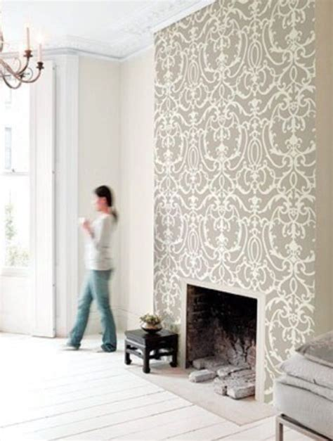 Wallpaper just the chimney breast, solid colour on other