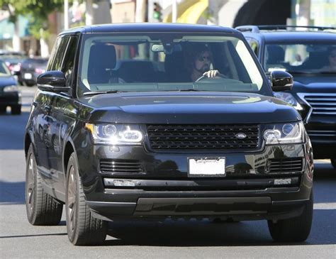 who owns kendall toyota billy cyrus drives a new range rover