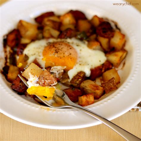 Baked Egg Potato baked egg roasted potatoes and sausage the weary chef