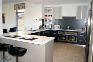 Home Kitchen Design kitchen island with sink and faucet with black barstools white kitchen
