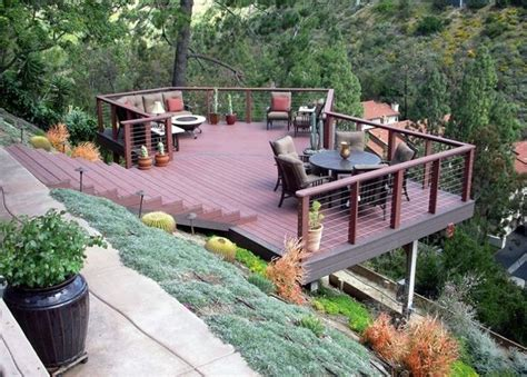 sloped backyard deck ideas 25 best ideas about steep hillside landscaping on