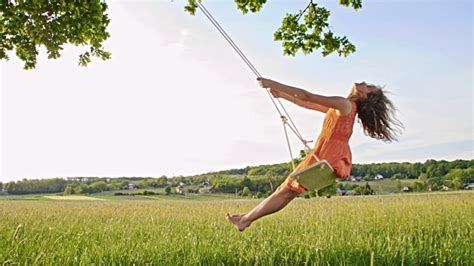swinging with slo mo girl swinging on a tree swing stock footage video