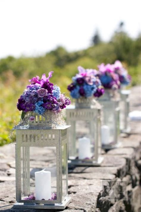 lanterns with flowers centerpieces candle lantern flower arrangements favething