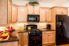 Wood Cabinets With Black Appliances by New Kitchen With Granite Countertops And Black Appliances