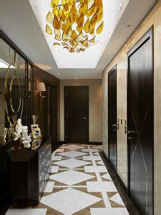entrance hall with statement sunburst mirror and marble entrance hall with statement sunburst mirror and marble