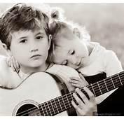 Kid Couple Romantic Girl And Boy Hug Playing Guitar