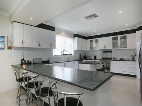 Flat Panel Kitchen Cabinets by Modern L Shaped Kitchen Design Using Granite Kitchen