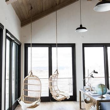 chairs hanging from ceiling white and blue living room with rope hanging chair