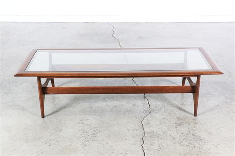 mid century glass coffee table mid century sculptural coffee table w glass top by