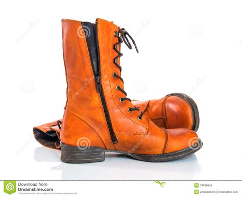 orange leather boots on white background royalty free