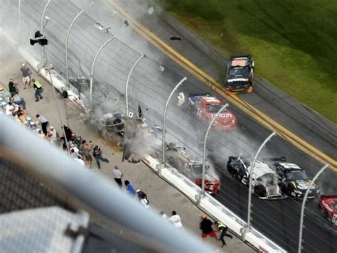 Wheels Fly Bye N2017 amazing impact from daytona nationwide wreck today with cameramen scrambling on impact of