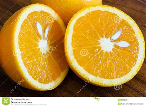 p fruits with seeds orange fruit cut in half stock photo image of half food