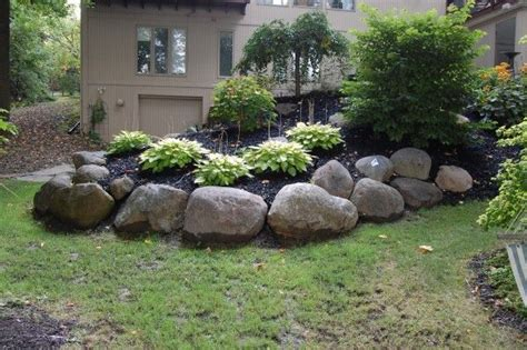 backyard berm others boulders need to be done with an artist fit them